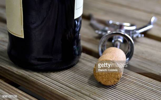 red wine bottle with corkscrew - wine cork stock photos and pictures
