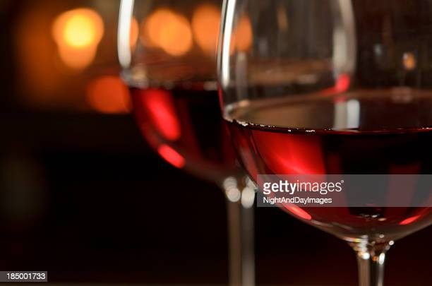 red wine by the fire - wine glass stock pictures, royalty-free photos & images