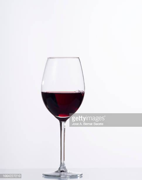 red wine  in glass in front of white background - red wine stock pictures, royalty-free photos & images