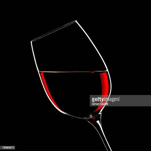 red wine in glass indoors - empty wine glass stock photos and pictures