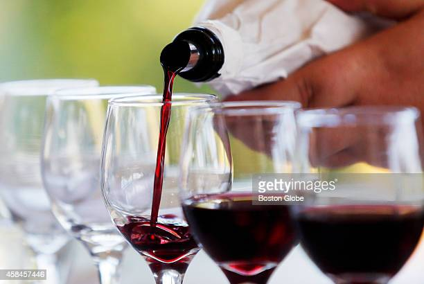 Red wine is poured during the Annual Plonkapalooza tasting of 50 wines at the Boston Globe in the Dorchester neighborhood on October 8 2014