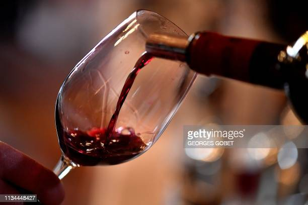 Red wine is served at a wine tasting session at the Chateau Carbonnieux in Cadaujac near Bordeaux southwestern France on April 2 during the official...