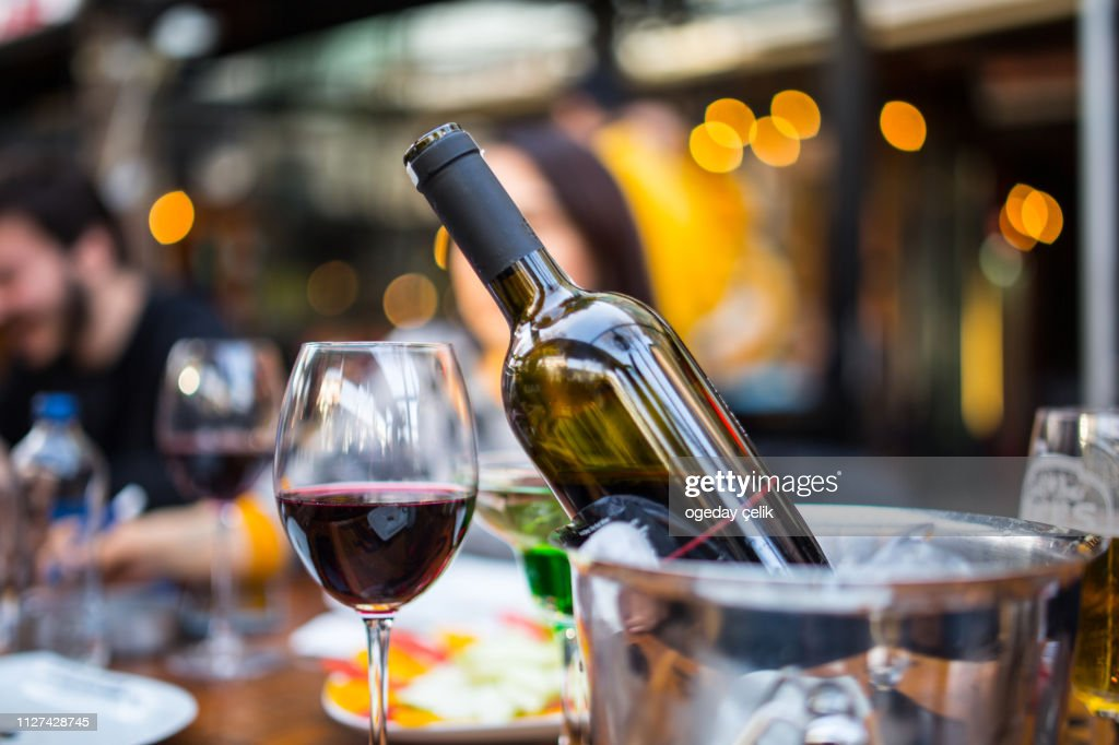 red wine on young adults valentines day table : Stock Photo