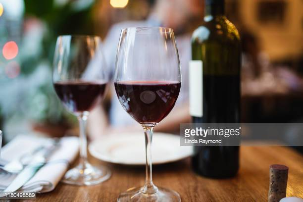 red wine - wine glass stock pictures, royalty-free photos & images
