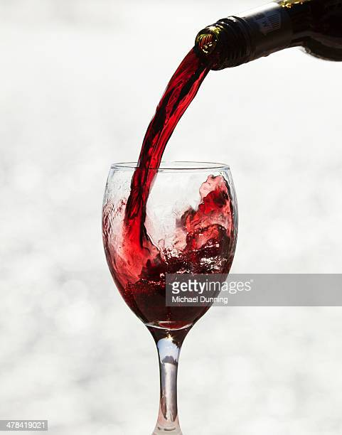 red wine - pouring stock pictures, royalty-free photos & images