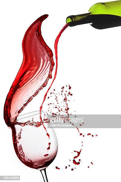 Red wine  poured into glas