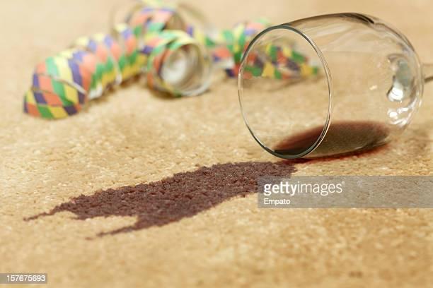 red wine spilled on a beige carpet. - red carpet event stockfoto's en -beelden