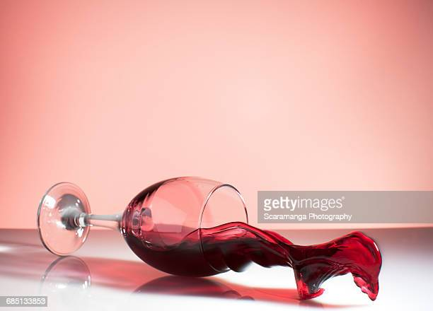 Red wine spilling from falling glass
