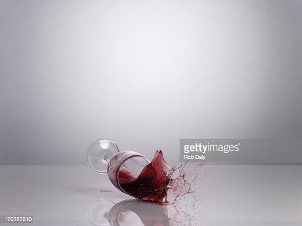 red wine spilling - spilling stock pictures, royalty-free photos & images