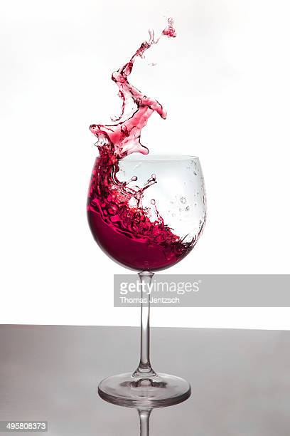 Red wine splashing out of a red wine glass