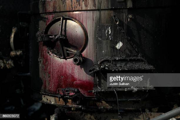 Red wine stains the front of wine making equipment at Paradise Ridge Winery that was destroyed by the Tubbs Fire on October 11 2017 in Santa Rosa...