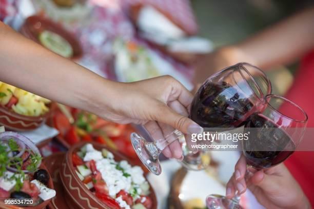 closeup friends doing wine tasting