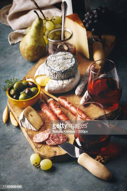 red wine with charcuterie assortment - charcuterie board stock pictures, royalty-free photos & images