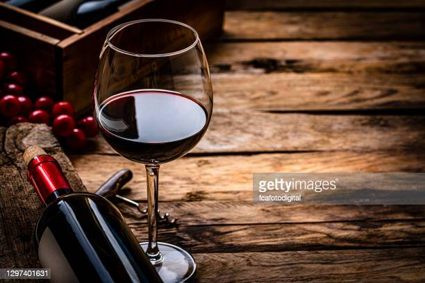 red wineglass and bottle. copy space - cabernet sauvignon grape stock pictures, royalty-free photos & images