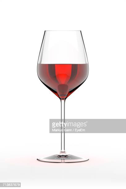 red wineglass on white background - copa de vino fotografías e imágenes de stock