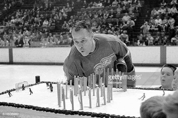 Red Wing hockey star Gordie Howe blows out the candles on a surprise three by five foot birthday cake prior to the 3/30 DetroitNew York game at...