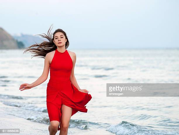 Red woman on the beach