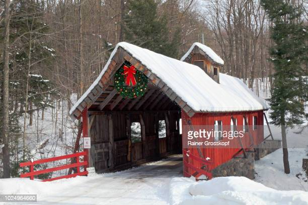 Red wooden Covered Bridge in winter