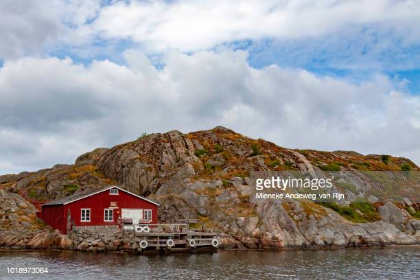 Red wooden fishing hut on the Swedish Archipelago, at Skärhamn, Skagerrak, Tjörn Municipality, Bohuslän, Västra Götaland Iän, Sweden