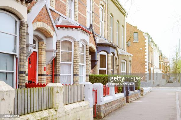 red wooden front door - terraced_house stock pictures, royalty-free photos & images