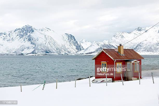 Red wooden home (rorbu) in winter on Lofoten Islands, Norway