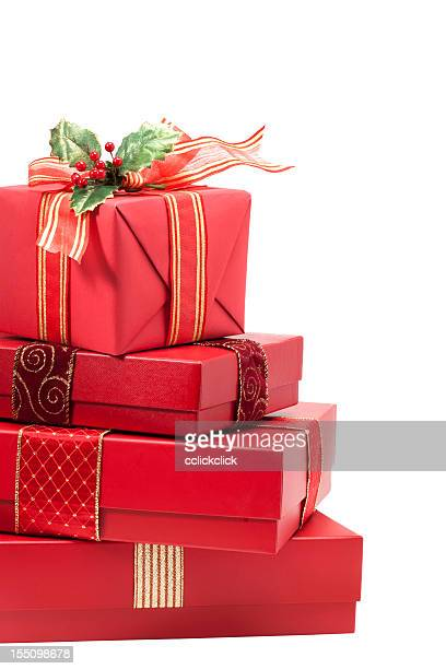 Red wrapped Christmas gifts against a white background