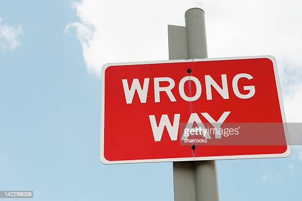 red wrong way street sign on post - wrong way stock pictures, royalty-free photos & images