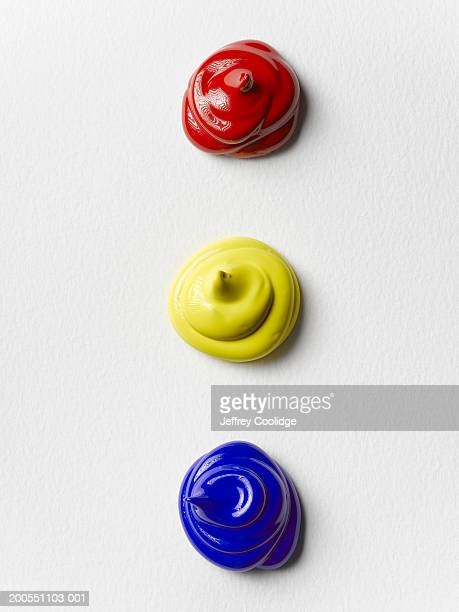 red, yellow and blue dabs of paint canvas - squirt foto e immagini stock
