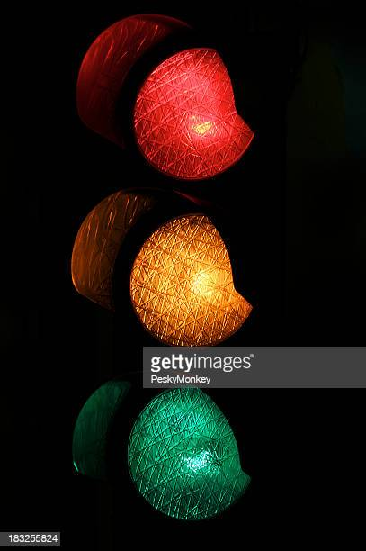 Red Yellow and Green Light Traffic Stoplight at Night