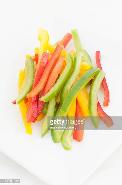 red, yellow and green sliced peppers - yellow bell pepper stock pictures, royalty-free photos & images