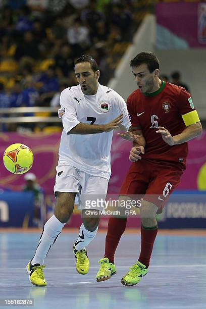 Reda Fathe of Libya loses the ball under pressure from Arnaldo of Portugal during the FIFA Futsal World Cup Group C match between Libya and Portugal...