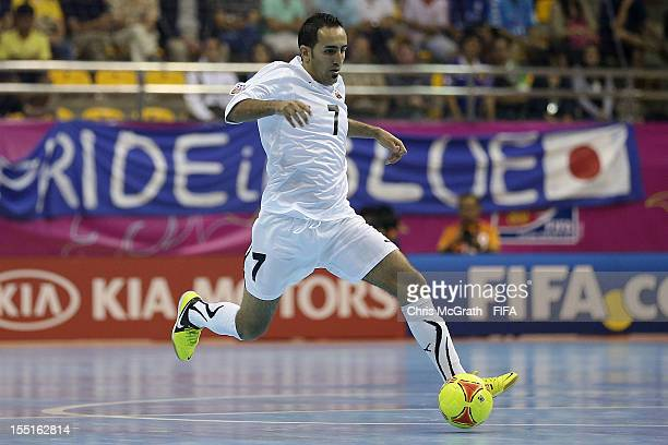 Reda Fathe of Libya makes a break against Portugal during the FIFA Futsal World Cup Group C match between Libya and Portugal at Korat Chatchai Hall...
