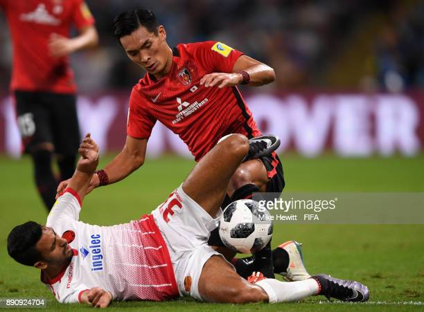 Reda Hajhouj of Wydad Casablanca and Tomoaki Makino of Urawa Reds clash during the FIFA Club World Cup UAE 2017 fifth place playoff match between...