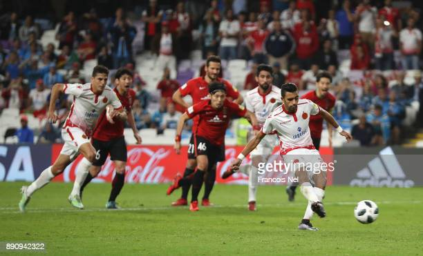 Reda Hajhouj of Wydad Casablanca scores from the penalty spot for his team's second goal during the FIFA Club World Cup UAE 2017 fifth place playoff...