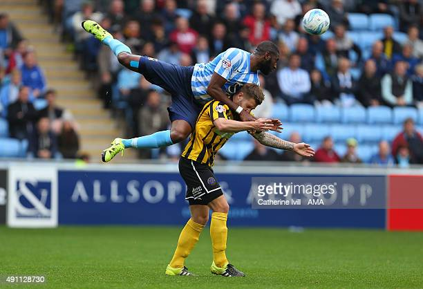 Reda Johnson of Coventry City goes over the top of James Collins of Shrewsbury Town during the Sky Bet League One match between Coventry City and...