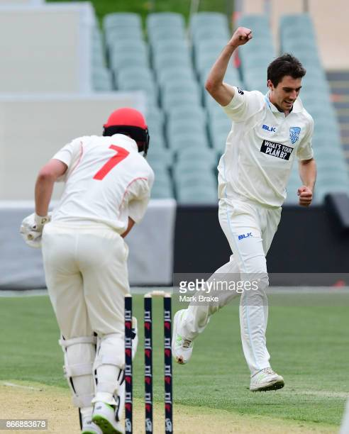 Redbacks John Dalton has his leg bail removed by NSW Pat Cummins during day one of the Sheffield Shield match between South Australia and New South...