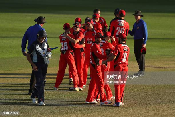 Redbacks players celebrate victory in the JLT One Day Cup match between Victoria and South Australia at North Sydney Oval on October 12 2017 in...