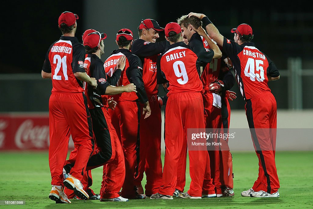 Redbacks players surround Kane Richardson after he got his fifth wicket during the Ryobi One Cup Day match between the South Australian Redbacks and the Victorian Bushrangers at Adelaide Oval on February 9, 2013 in Adelaide, Australia.