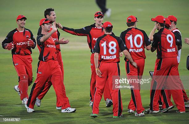 Redbacks teammates celebrate during the Airtel Champions League Twenty20 semi final match between South Australian Redbacks and Chevrolet Warriors at...