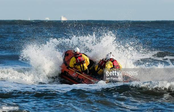 Redcar RNLI launch their lifeboat to watch over hundreds of people as they race into the cold waters of the North Sea to take part in the annual...