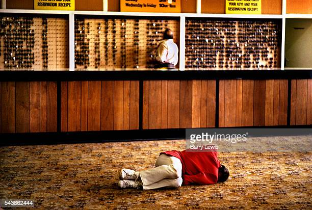 Redcoat asleep on the lobby floor of Butlins holiday camp Skegness The idea for the Red Coats came to Butlin early on in the Skegness Camp's first...