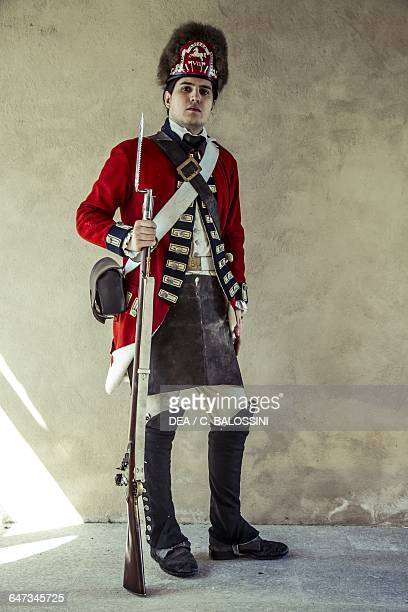 Redcoat British army soldier with fur hat and muzzleloading rifle American Revolutionary War 18th century Historical reenactment