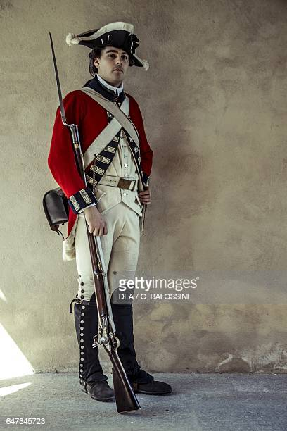 Redcoat British army soldier with tricorn hat and muzzleloading rifle American Revolutionary War 18th century Historical reenactment