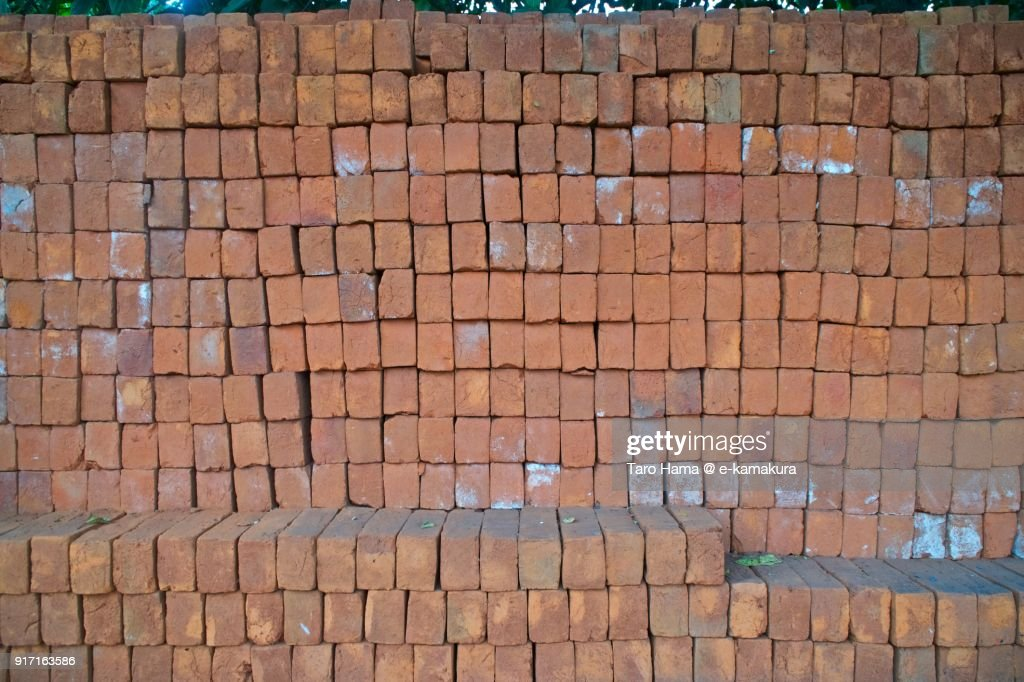 Red-colored bricks piling on the road Nagalli Hills Colony in Dona Paula in Goa in India : ストックフォト