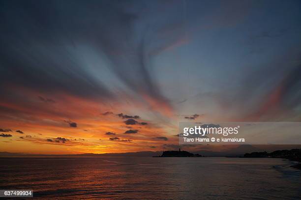 Red-colored cloud on the sunset beach and Enoshima island