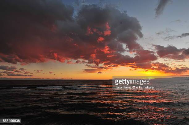Red-colored cloud on the sunset beach