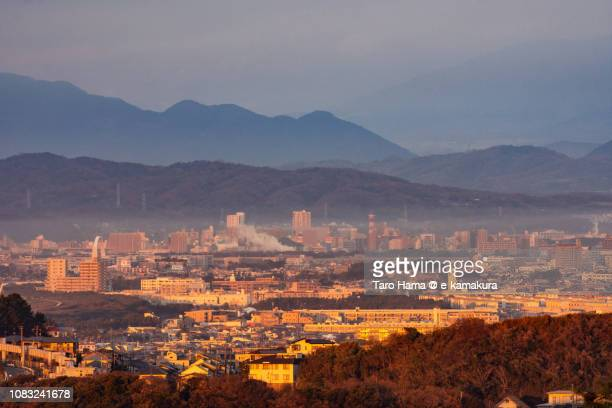red-colored fujisawa, chigasaki and hiratsuka cities by rising sun in kanagawa prefecture in japan - chigasaki stock pictures, royalty-free photos & images