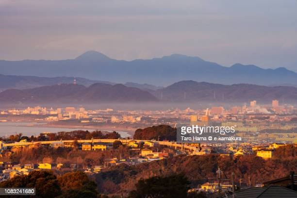 red-colored kamakura, chigasaki and hiratsuka cities by rising sun in kanagawa prefecture and sagami bay, northern pacific ocean in japan - chigasaki stock pictures, royalty-free photos & images