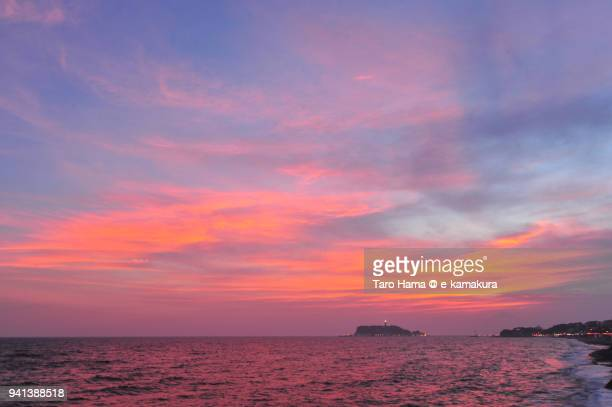 Red-colored sunset clouds on Enoshima Island in Fujisawa city and Sagami Bay, Northern Pacific Ocean in Japan