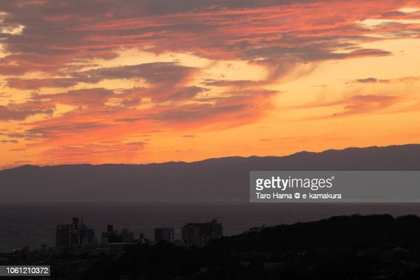 Red-colored sunset clouds on Sagami Bay and Izu Peninsula in Japan